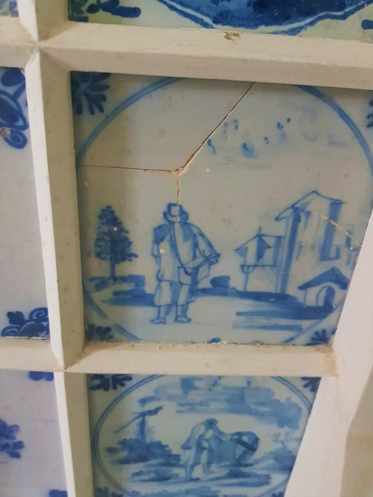 blue painted tiles with crack down the middle
