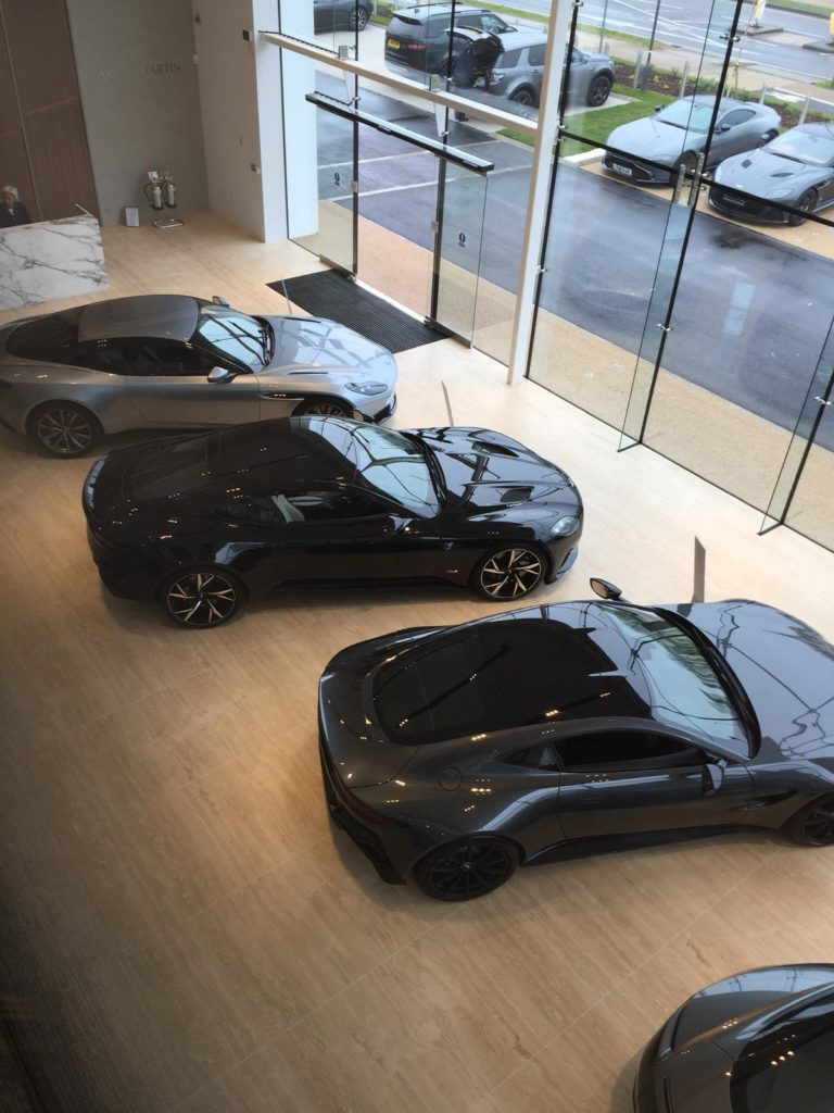 four black cars in a showroom window