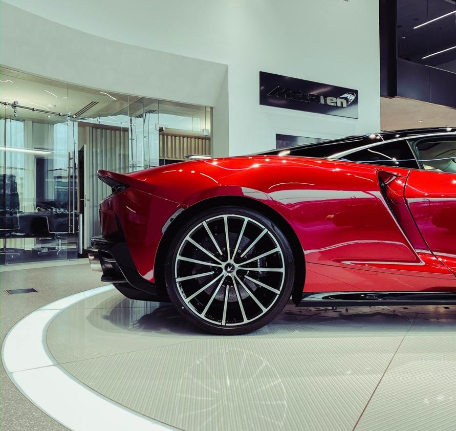 red supercar in a showroom